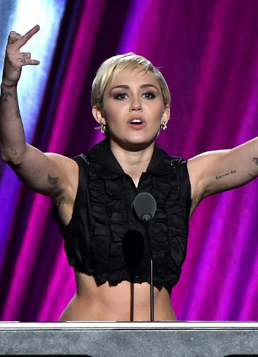 Miley Cyrus Rocks Pasties and Armpit Hair